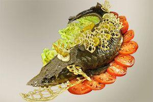 Готовую рыбу переложить на украшенную овощами тарелку. Оформить  узорами из заварного теста и лимоном